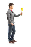 Smiling man holding a bunch of flowers