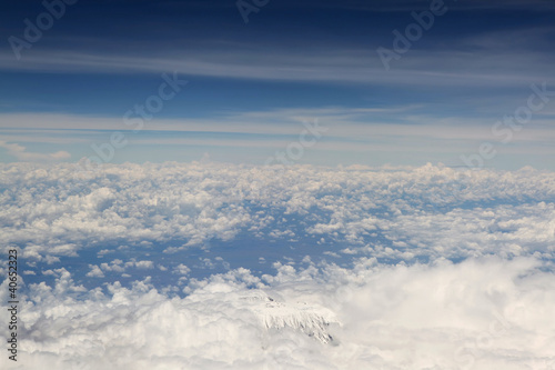 Kilimanjaro top from above, surrounded with white clouds
