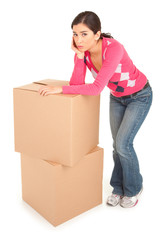 Tired Looking Woman Leaning on Boxes