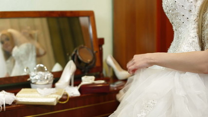 DOLLY: Bride Trying On A Wedding Dress