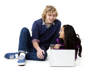 young man and woman working on a laptop