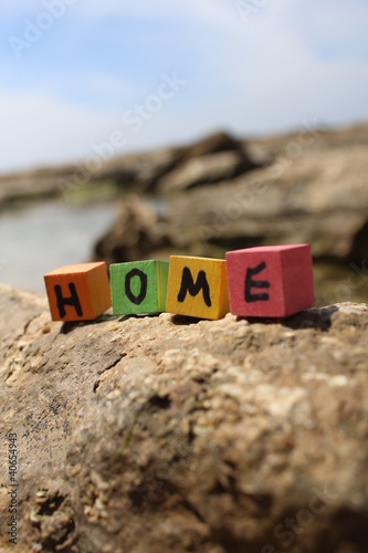 The word HOME written on wooden cubes