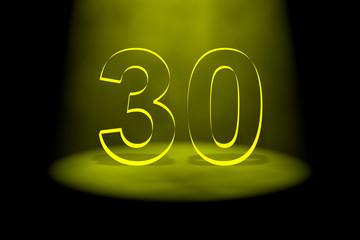 Number 30 illuminated with yellow light