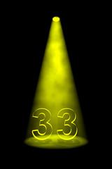 Number 33 illuminated with yellow spotlight