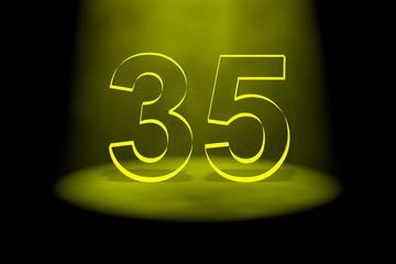 Number 35 illuminated with yellow light