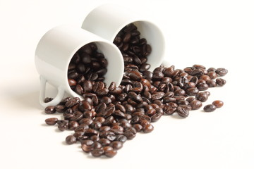 Coffee beans with a white ceramic cup