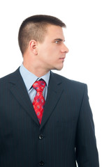 Serious attractive young businessman from profile