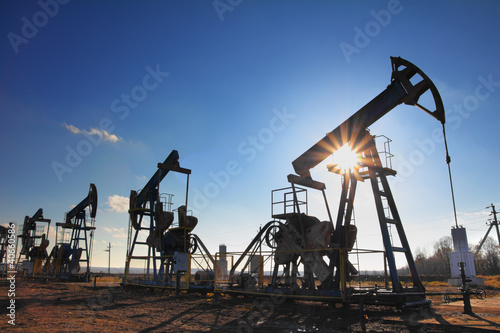 working oil pumps silhouette - 40660586