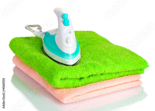 Two towels and iron isolated on white