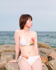 Brightness of bare skin / Beautiful girl / Seaside