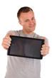 Junger Mann mit Tablet PC