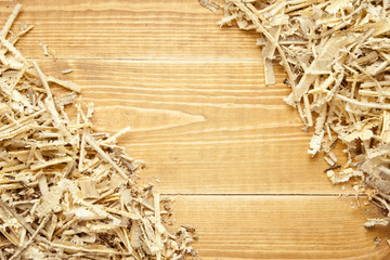 Wooden sawdust and shavings background with space for text
