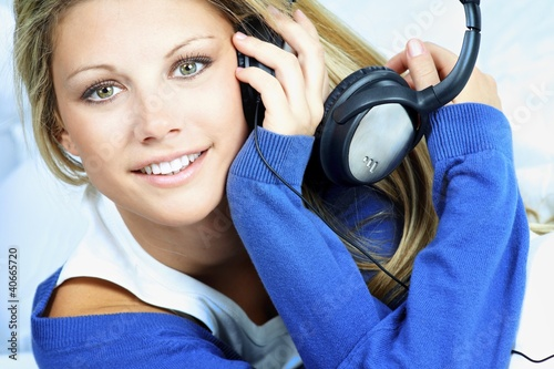 young woman listen music
