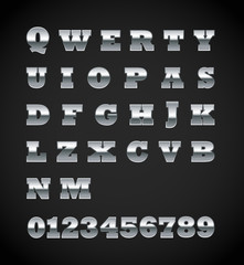 Set of matte metal letters on black