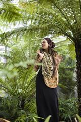 young pretty woman among palms dancing