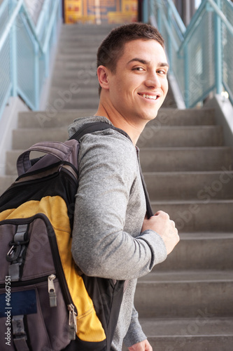 young male college student with backpack