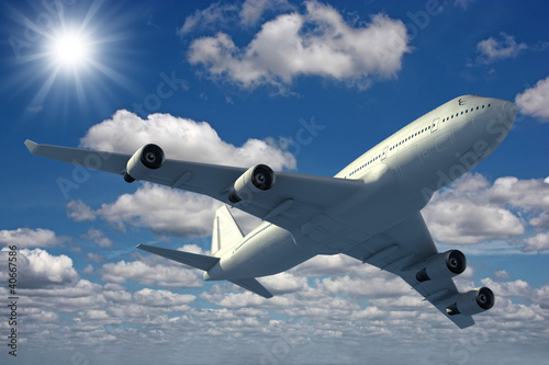 samolot-latajacy-na-niebieskim-niebie