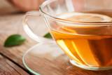 Fototapety Cup of organic lemon fruit tea