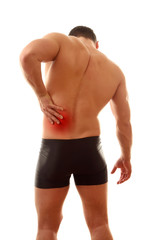 Healthy young man with pain in his back isolated
