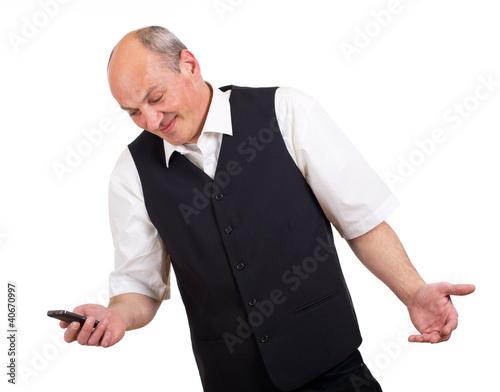 ahnungsloser Geschäftsmann mit Telefon in der Hand