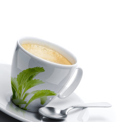 cup of coffee decorated stevia rebaudiana leaf