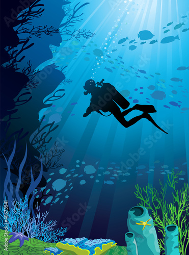 Beautiful coral reef and silhouettes of diver