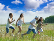 women with teens running in grass