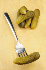 Pickled gherkins on a cutting board
