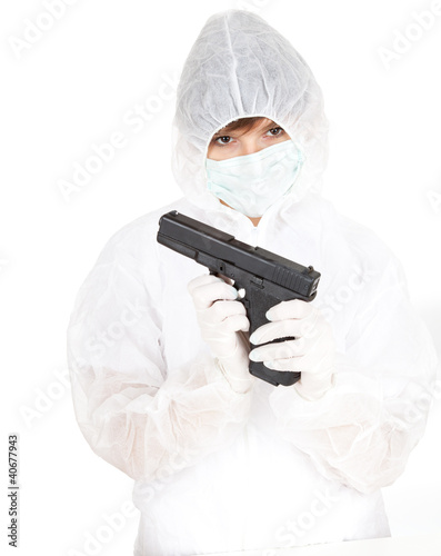young woman in protective uniform and mask with gun
