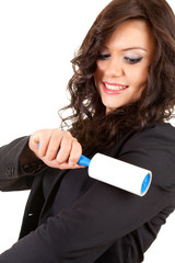 business woman cleaning dust with lint roller