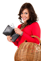 smiling shopping girl keeping wallet with dollars