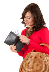 cheerful young woman looking to the wallet with dollars