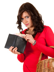 sad young woman looking to the wallet with euro