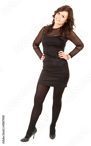 smiling young elegant girl in black dress, full length
