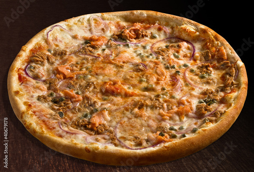Pizza pesce with tuna fish, salmon, onion and capers - isolated