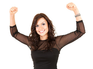 smiling elegant teenage girl in black dress with raised fists