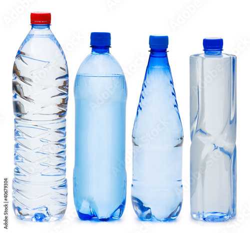Many water bottles isolated on white