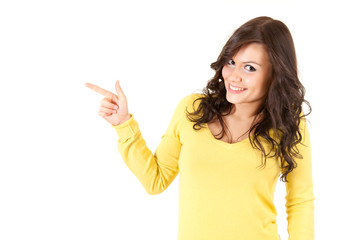 cheerful young woman pointing up, white background