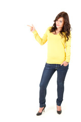 standing casual young woman pointing up, ful length