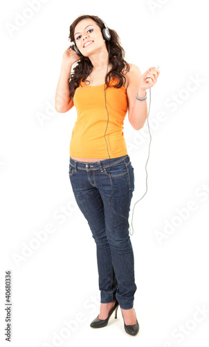 enjoy music teenage girl in headphones, full length