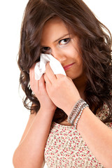 crying teenage girl with handkerchief, white background