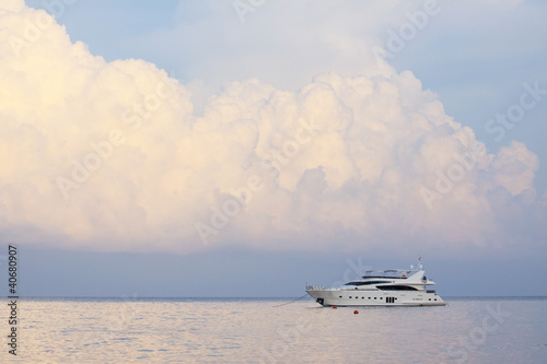 white yatch and plain sea blue sky white clouds