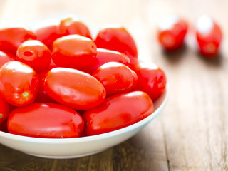 close up of a bowl of roma tomatoes