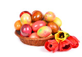 Colorful dyed Easter eggs placed in a wooden basket poster