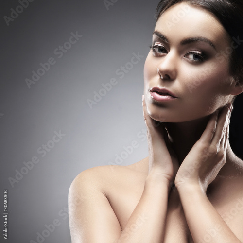 Portrait of a young and attractive woman in makeup