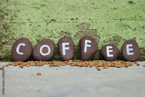 coffee on some pebbles and skilled wall background