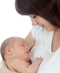 Close-up young mother holding her newborn baby isolated on white