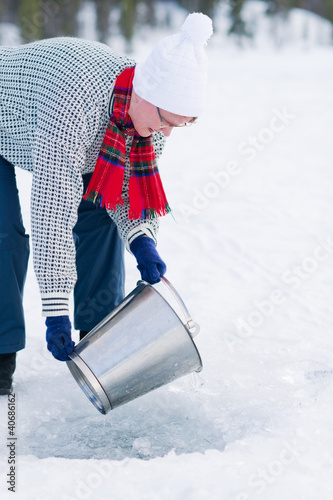 Woman and bucket