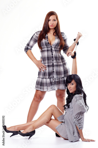 Two young women in handcuffs