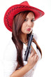Young woman with gun and red cowboy hat